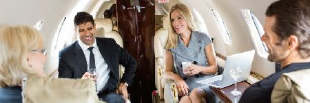 business professionals having drinks on a private jet